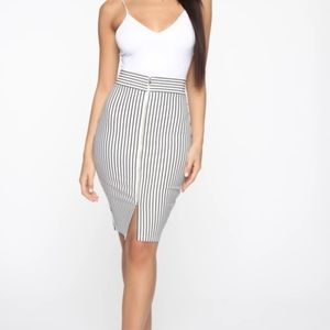 Knee length pencil skirt with slit and zip front.